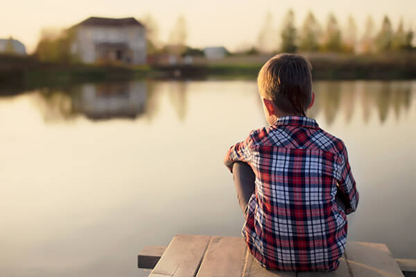 Child Looking at Water alone